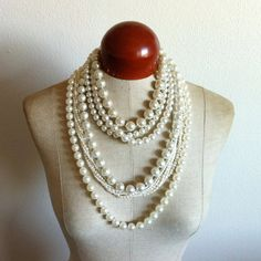 I have been wearing my opera length pearls a lot this fall. Paired with skinny scarves or alone.