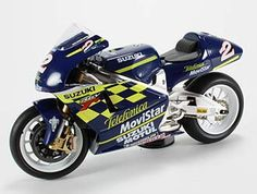 This Suzuki RGV 500 (Kenny Roberts Jr - 2000) Diecast Model Motorcycle is Blue and features working stand, steering, wheels. It is made by Ex Mag and is 1:12 scale (approx. 17cm / 6.7in long). Please note: imperfect outer packaging on this item....
