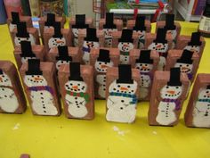 Snowmen bricks.  I made them as a holiday project in my classroom.  They're made out of brick pavers, tempera paints, and felt.  The total cost was less than $1.00 a piece!