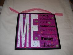 """All About Me Girls Bedroom Wall Art Sign Cool Creative Awesome Funny Peace Signs Hearts by The Little Store Of Home Decor. $14.99. Made of Wood. made in the USA. size 13x13. We've sealed this All About Me print onto wood giving it a framed appearance. The background wood is painted black and it measures approximately 13"""" squared by 1/4"""" thick (wood dimensions not including hanger). We've added a hot pink ribbon for easy hanging and added charm. Save 25% Off!"""
