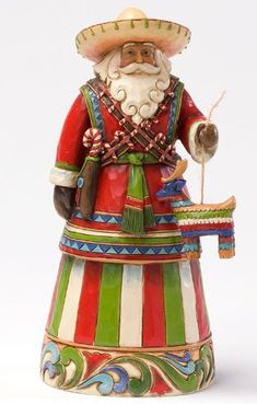 Feliz Navidad--Mexican Santa - This south of the border Mexican Santa is a natural addition to the Santas Around the World collection. He is enjoying the merriest of Mexican Christmas traditions the pinata. Note the beautiful detail in the sombrero and candy cane in his holster. The Heartwood Creek Collection by Jim Shore combines popular folk art with rich elements of authentic quilt designs.