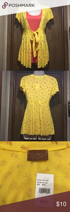 Yellow Front Tie empire waist blouse small Ladies yellow empire waist, front-tie blouse by The Rag Story size Small. Short sleeve. The Rag Story Tops Blouses