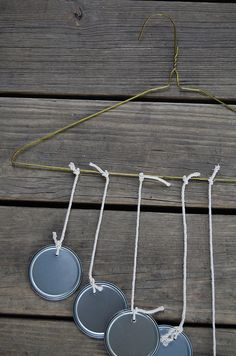 recycled wind chime tutorial  This is cool, but I would find something different than a hanger, and I wouldn't use the white yarn.. Makes it look messy.