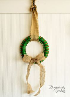 Clamp Christmas Wreath using plumbing clamps and paint