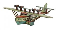 extraordinary one-of-a-kind c. 1930's museum quality american folk art handcrafted polychromatic enameled wood dornier do x model flying boat with allover crazed finish