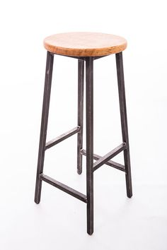 Simple design industrial bar stool made from 20mm steel square section. Welds are left 'proud'. Seat top made from a single piece of English