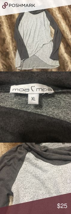 NWOT Cozy cowl neck sweatshirt Super soft material. Light and dark gray. Bought at Gliks. Never worn (NWOT). Save 15% on all bundles of two items or more! Moa Moa Tops Sweatshirts & Hoodies