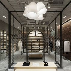 Martagon :: Japanese designer Reiichi Ikeda has built a wire mesh box in the middle of a fashion boutique in Osaka.