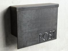 and crafted from heavy-gauge steel and features a flip top opening. The face of the mailbox is composed of 1/4-inch-thic
