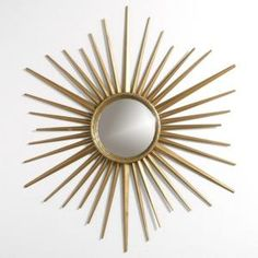 A wall with many of these would be cool.  Martha Stewart starburst mirror from Home Depot - only $35!