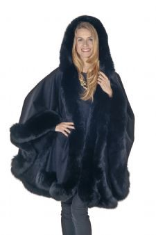 """Black Plus Sized Cashmere Cape Fabric Content: 100% Cashmere . Fur Content :Dyed Black Fox. Fur Origin: Finland. Snap at sleeves allows you to wear the cape with a full sweep or use the snap to form a sleeve. Hook and eye fur closure at the top. Length: 34"""" from under fur neckline to hemline at center back. Sweep: approx. 200"""" from tip to tip.$995.00"""