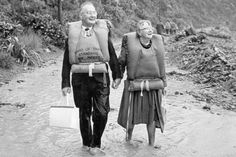 An elderly couple walk hand in hand away from the shore. 45 years since Wahine Inside Wellington's famous disaster Go to: www.stuff.co.nz