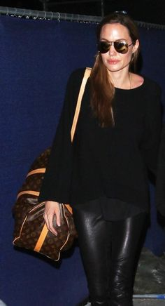 """Angelina Jolie travels with a Louis Vuitton """"Keepall 45"""" luggage"""