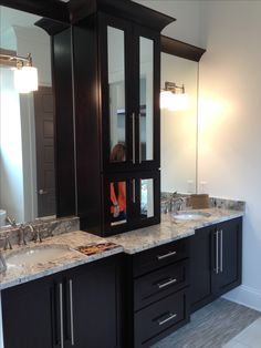 Master Bathroom: storage cabinet with crown molding to break up large mirror in bathroom