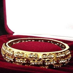 Jackie's Driftwood bracelet was another gift from JFK. Set in 18k gold, the bangle style bracelet featured 82 diamonds.