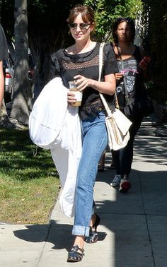 Dakota Johnson's rolled up boyfriend jeans look perfect with black sandals and that pretty boho style top. http://thestir.cafemom.com/beauty_style/189274/dakota_johnsons_street_style_in