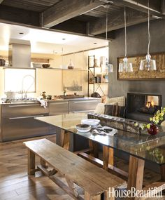 The stainless steel glows in the northern light, but it's the fireplace that keeps you warm in this Mammoth Lakes, California, kitchen by Mark Egerstrom.   - HouseBeautiful.com