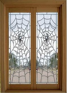 Spider web stained glass french doors