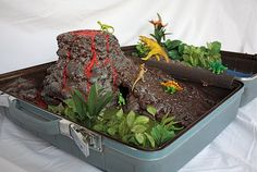 dinosaur play set in a suitcase- I made one of these for 5 y.o. daughter's b-day. she loves it