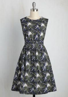 There's no such thing as overloading on fun - but if it were possible, why not go all-out in this white A-line! From hard-to-find British brand Emily and Fin, this navy and green frock features a natural waist, a flared skirt, and an illustrated frond print for a vintage-inspired look that will make you giddy!