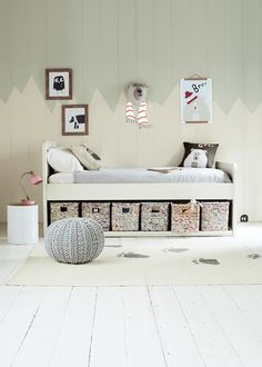 We've given this storage-packed bed a lick of white paint that goes amazingly with baskets woven from recycled magazines. The name says it all really.