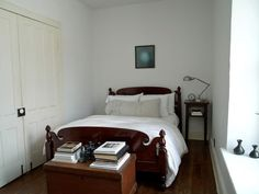 A small, compact yet elegantly designed room with a bed and an extension table for keeping books.
