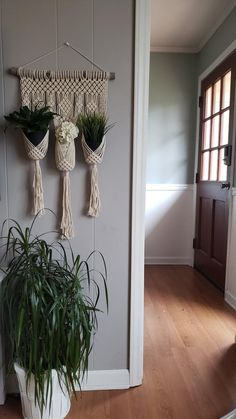 Macrame wall hanging with 3 holders, perfect for small plants or your favorite decorative container! Tied with 3 mm, off-white cotton rope. This plant hanger can hold pots with a base diameter up to 4 inches, but looks best with pots with a base diameter of 3 inches or less. Length: approx. 28 in.