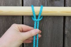 Wrap the loop around the dowel and pull the tails through.