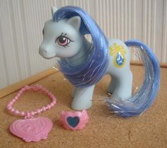 Baby Sapphire ...  A blue Jewellery Baby Pony with dark blue and silver tinselled hair.  A blue and yellow jewel as a symbol.  A year 12 Earth Pony.