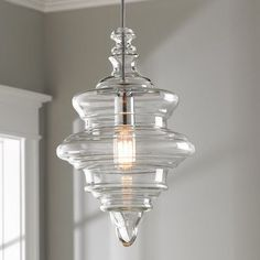 The fluid form of our Closed Glass Spool Pendant has distinct levels throughout the body. The clear glass shade is detailed with chrome hardware for a brighter shine in your modern or farmhouse themed space. Clear Glass Pendant Light, Glass Pendant Shades, Glass Chandelier, Glass Pendants, Glass Shades, Linear Chandelier, Chandelier Shades, Farmhouse Pendant Lighting, Kitchen Pendant Lighting