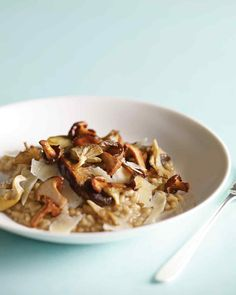 Mushroom Risotto | Martha Stewart Living - The flavors of dried and fresh mushrooms carry through in this proper Italian risotto, made from plump Arborio rice, which absorbs plenty of mushroom stock until it's meltingly tender on the outside but still sturdy within.