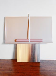 Laurie Kang creates an intriguing angle of paper, glass and steel through her works.