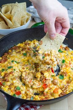 Breakfast Queso Fundido ..Hot cheesy dip with scrambled eggs and sausage