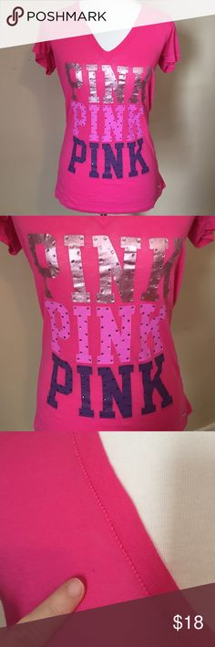 VS Pink rhinestone t-shirt So cute! I love this shirt! Excellent condition. All rhinestones are intact. One tiny spot pointed out in last photo. Barely noticeable. Reflected in price. Smoke free home. PINK Victoria's Secret Tops Tees - Short Sleeve