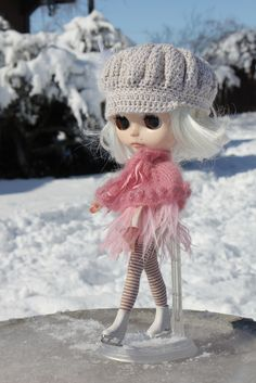 https://flic.kr/p/dX2oHf | Elly finally got her Ice... | The bird bath prior to melting it  again...  Elly loves her cape from Tracey and her ice skates from my sis