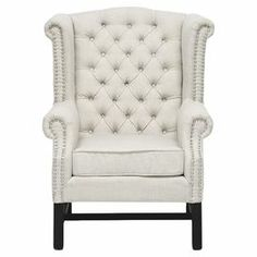 """Curl up with your favorite read in this lovely wingback arm chair, showcasing classic tufted linen upholstery and nailhead trim.    Product: ChairConstruction Material: Linen, foam and birch woodColor: BeigeFeatures:  Nailhead trimButton-tuftedRemovable seat cushion Dimensions: 42.5"""" H x 32.6"""" W x 32.6"""" DNote: Assembly required, hardware includedCleaning and Care: Spot clean only"""