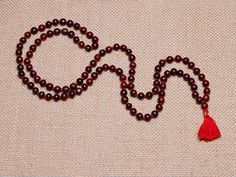 This mala is so beautiful and strong! An excellent deal. Rosewood is known for removing obstacles, protection, and health. I have been using a mala in my meditations for a few years now. It keeps me consistent in my practice  and helps me stay rooted in the moment!