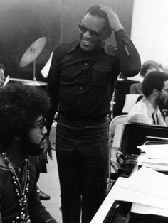 """""""Rehearsing with his band, Ray Charles is in complete control. In his presence, one almost forgets that he is sightless because he seems so completely aware of everything going on"""" (1974). Photo by Ted Williams, for Ebony."""