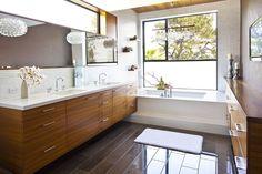 Sleek, modern bathroom. Turn the tub into a walk-in shower and heated floor=perfect!