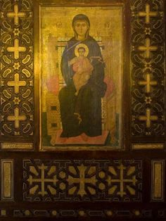 Icon of the Virgin seated with Christ. 13th C. Ebony and ivory inlaid frame. St Barbara Church, Cairo.