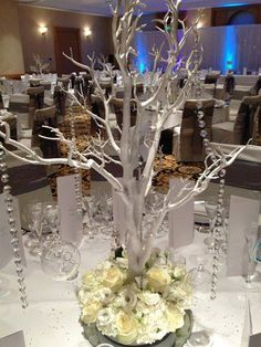 Crystal tree with hanging crystals, tealights and floral arrangement around base