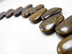 22mm Submetallic Luster Bronzite Trapezoid 8 inches B3055 By emass. Price: $7.50