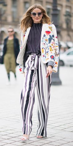 Street-style darling Olivia Palermo hit the Paris Haute Couture Fashion Week circuit, making the rounds in one on-point outfit after another. For the Schiaparelli show, she mixed stripes with a pinstriped top and wide-leg pants, topping it off with an Insta-worthy Schiaparelli Couture embroidered blazer and white sandals.