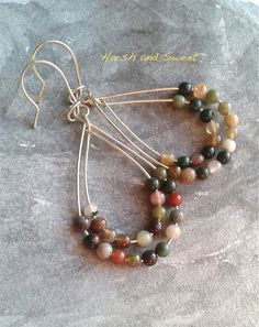Indian agate and sterling silver dangle earrings by Harsh and Sweet on Etsy. Two strands of colorful Indian agate make up these whimsical dangle earrings. The beautiful tones of each bead add a colorful touch to the classical teardrop shape.