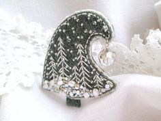 Christmas Tree gray felt brooch. Embroidered Beaded Brooch.Christmas brooch. Embroidered beaded Christmas tree.Snowflakes Christmas Tree.Winter Landscape Brooch.  Christmas gift for her. Gift for mom. UNIQUE SINGLE COPY textile brooch by me.  Felt brooch based on filz imparting a convex shape and density. Hand embroidered. Hand stitching. Beadwork gives a festive shimmer Safety pin on the back side.  The brooch looks great on sweater, jacket, scarf, hat or purse. Be creative! Make your…