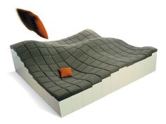 This Wavy Sofa is Assembled from a Hilly Surface of Multi-Height Blocks #seating trendhunter.com
