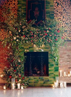 Wedding ceremony backdrop of greenery with flowers and candles at The Bowery Hotel.