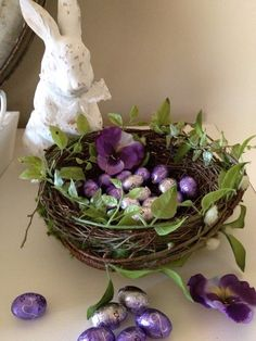 alternative candy dish: foil-wrapped chocolates in a grapevine nest with purple pansies | from kendrasmiles4u.tumblr