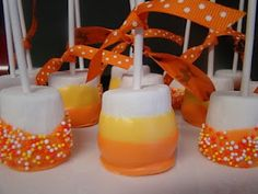 Candy Corn Marshmallow Pops made with 2 shades of tinted white chocolate + sprinkles. Easy peasy.