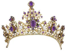 A pearl and amethyst tiara. Of openwork scrolling design, set with baroque pearls and graduated oval-cut and circular-cut amethysts in foiled closed back settings.